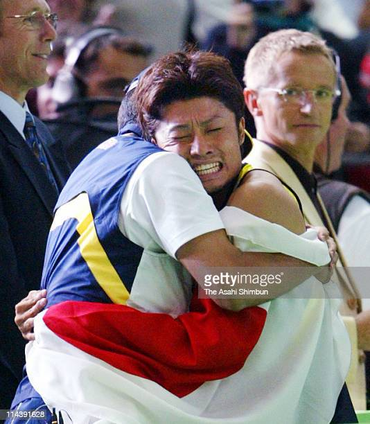 Shingo Suetsugu of Japan celebrates the bronze medal in the men's 200m final with his coach Susumu Takano during the 9th IAAF World Athletics...