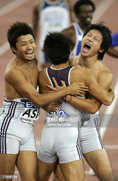 Shingo Suetsugu of Japan celebrates third place with Shinji Takahira in the 4 x 100 m Relay event during the 10th IAAF World Cup at the Olympic...