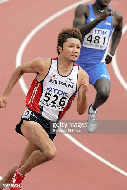 Shingo Suetsugu of Japan competes in the Men's 200m first round during day four of the IAAF World Championships at the Olympic Stadium on August 9...