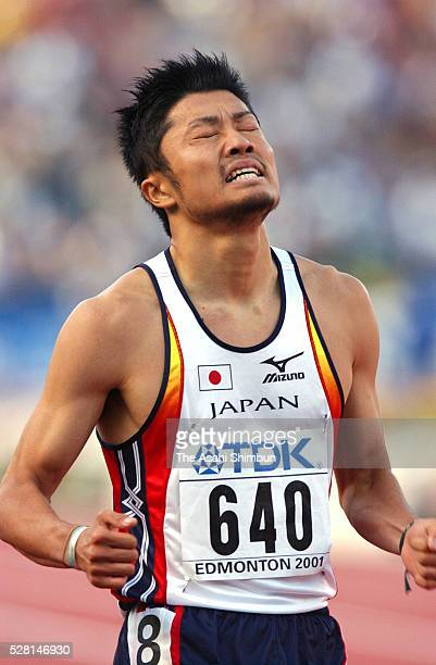 Shingo Suetsugu of Japan reacts after the Men's 200m semi final during the IAAF World Championships at the Commonwealth Stadium on August 9 2001 in...