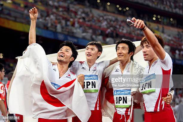 Shingo Suetsugu Shinji Takahira Nobuharu Asahara and Naoki Tsukahara of Japan celebrate winning a bronze medal in the Men's 4 x 100m Relay Final at...