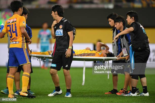 Shingo Tomita of Vegalta Sendai is taken off by a stretcher during the JLeague J1 match between Vegalta Sendai and Sagan Tosu at Yurtec Stadium...