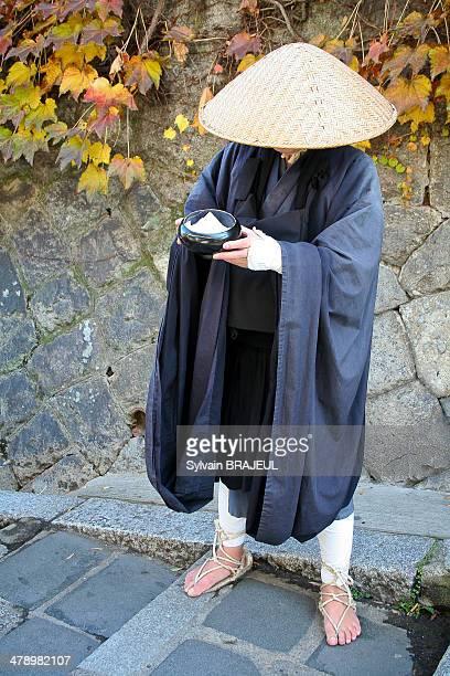 Shingon monk begging at the Kyomizu dera temple Kyoto Japan