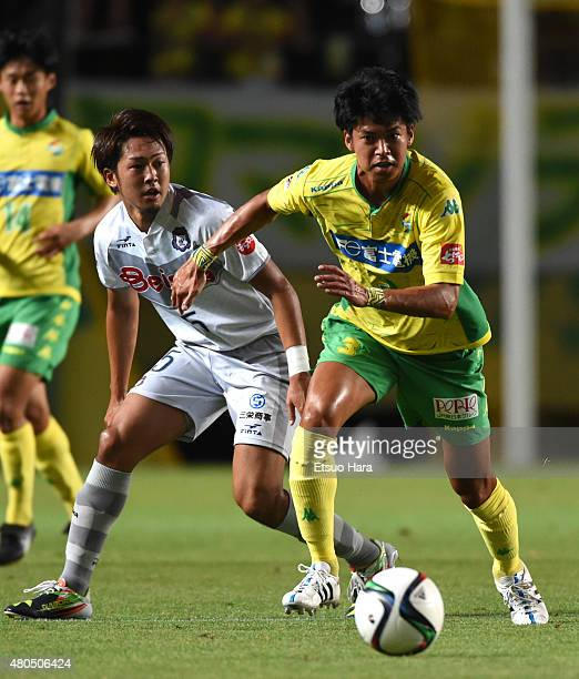 Shinichi Tashiro of JEF United and Ryohei Yoshihama of Thespa compete for the ball during the JLeague second division match between JEF United Chiba...