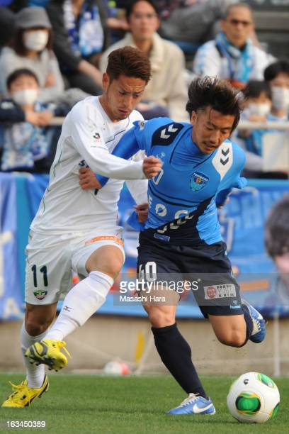 Shinichi Terada of Yokohama FC and Tomohiro Tsuda of Tokushima Vortis compete for the ball during the J.League Devision 2 match between Yokohama FC...