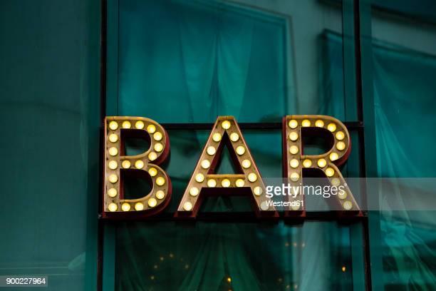 shining bar sign - bord bericht stockfoto's en -beelden