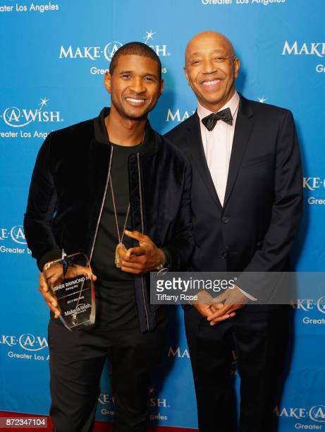 Shining Star award recipient Usher Raymond IV and music producer Russell Simmons at the 2017 Make a Wish Gala on November 9 2017 in Los Angeles...