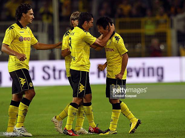 Shinja Kagawa of Dortmund celebrates the first goal with Mats Hummels and Nuri Sahin during the UEFA Europa League PlayOff match between Borussia...