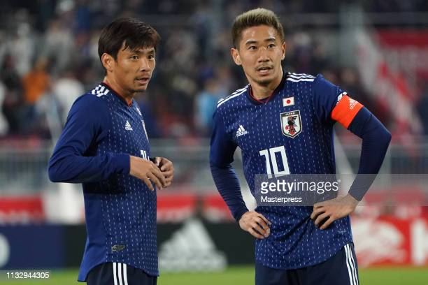 Shinji Kagawa and Takashi Inui of Japan talk during the international friendly match between Japan and Bolivia at Noevir Stadium Kobe on March 26...