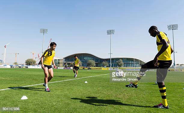 Shinji Kagawa and Adrian Ramos of Borussia Dortmund during a training session of the Borussia Dortmund training camp at Dubai Nad Al Sheba Sports...