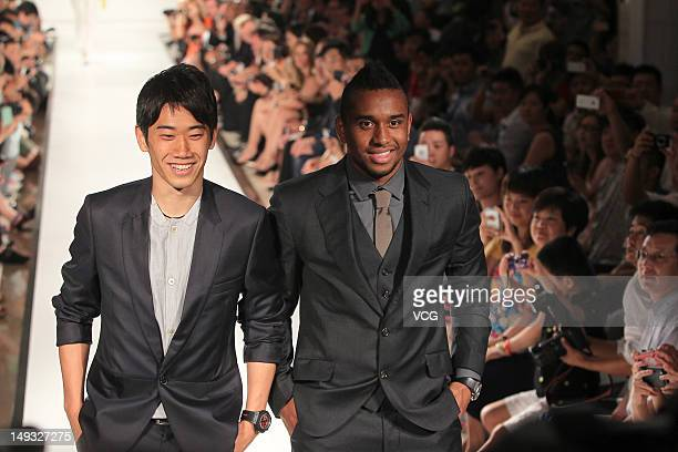 Shinji Kagawa and Anderson of Manchester United pose during a Hublot Charity Dinner and Fashion Show event in aid of the MU Foundation at ShangriLa...