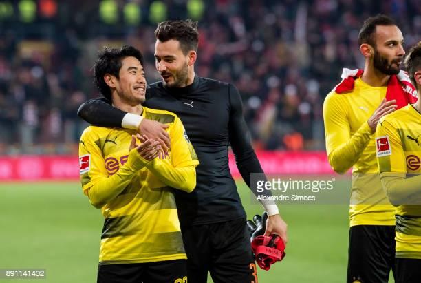 Shinji Kagawa and goal keeper Roman Buerki of Borussia Dortmund celebrate the win together after the final whistle during the Bundesliga match...