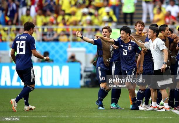 Shinji Kagawa and Hiroki Sakai of Japan celebrate after Yuya Osako of Japan scoried the 2nd Japan goal to make it 21 during the 2018 FIFA World Cup...