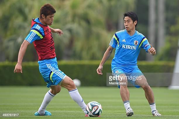 Shinji Kagawa and Hiroki Sakai of Japan in action during the training session on May 22 2014 in Ibusuki Kagoshima Japan