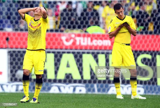 Shinji Kagawa and Ivan Perisic of Dortmund looks dejected after the Bundesliga match between Hannover 96 and Borussia Dortmund at AWD Arena on...