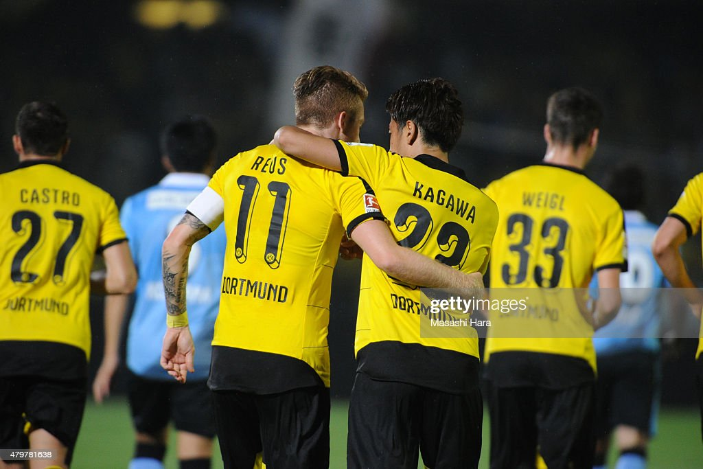 Shinji Kagawa #23 (R) and Marco Reus #11 Borussia Dortmund celebrate the first goal during the preseason friendly match between Kawasaki Frontale and Borussia Dortmund at Todoroki Stadium on July 7, 2015 in Kawasaki, Kanagawa, Japan.