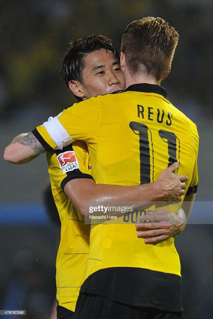Shinji Kagawa #23 (L) and Marco Reus #11 Borussia Dortmund celebrate the second goal during the preseason friendly match between Kawasaki Frontale and Borussia Dortmund at Todoroki Stadium on July 7, 2015 in Kawasaki, Kanagawa, Japan.
