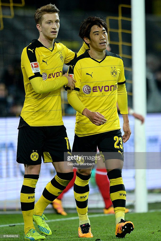 Shinji Kagawa (R) and Marco Reus (L) of Dortmund react after scoring the second goal during the Bundesliga match between Borussia Dortmund and 1. FSV Mainz 05 at Signal Iduna Park on March 13, 2016 in Dortmund, Germany.