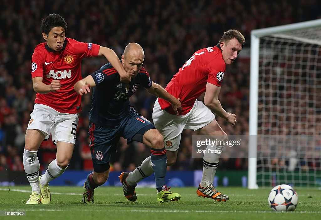 Shinji Kagawa and Phil Jones of Manchester United in action with Arjen Robben of Bayern Munich during the UEFA Champions League quarter-final first leg match between Manchester United and Bayern Munich at Old Trafford on April 1, 2014 in Manchester, England.