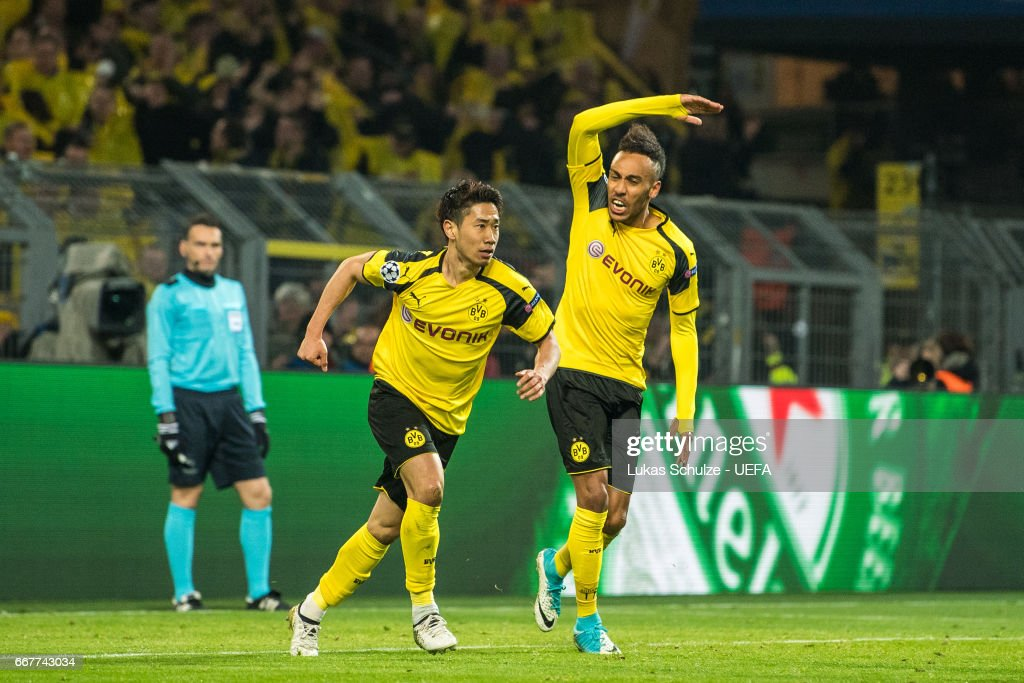 Shinji Kagawa (M) and Pierre-Emerick Aubameyang (R) of Dortmund celebrate their teams first goal during the UEFA Champions League Quarter Final first leg match between Borussia Dortmund and AS Monaco at Signal Iduna Park on April 12, 2017 in Dortmund, Germany.