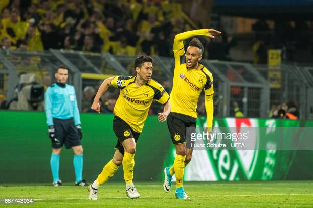 Shinji Kagawa and PierreEmerick Aubameyang of Dortmund celebrate their teams first goal during the UEFA Champions League Quarter Final first leg...