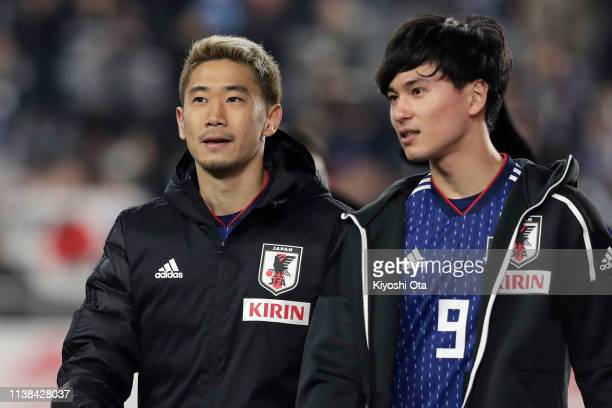 Shinji Kagawa and Takumi Minamino of Japan look on while greeting supporters after the international friendly match between Japan and Bolivia at...