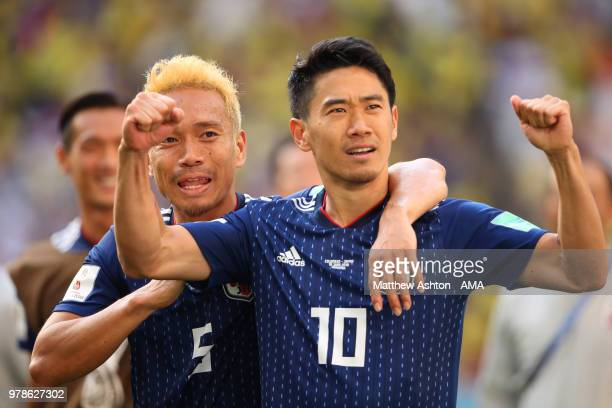 Shinji Kagawa and Yuto Nagatomo of Japan celebrate at the end of the 2018 FIFA World Cup Russia group H match between Colombia and Japan at Mordovia...