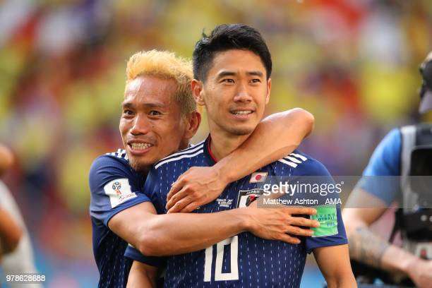 Shinji Kagawa and Yuto Nagatomo of Japan celebrate at the end of the 2018 FIFA World Cup Russia group H match between Colombia and Japan at Mordovia...