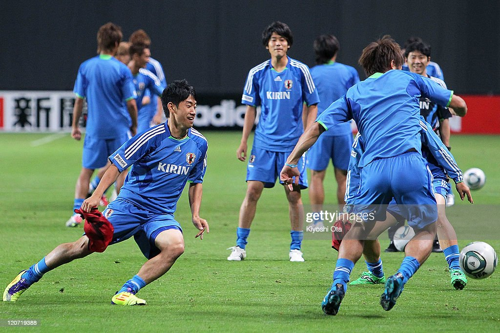 Shinji Kagawa (L) contests the ball during the Japan national team training session ahead of the Kirin Challenge Cup international friendly match against South Korea at Sapporo Dome on August 9, 2011 in Sapporo, Japan.