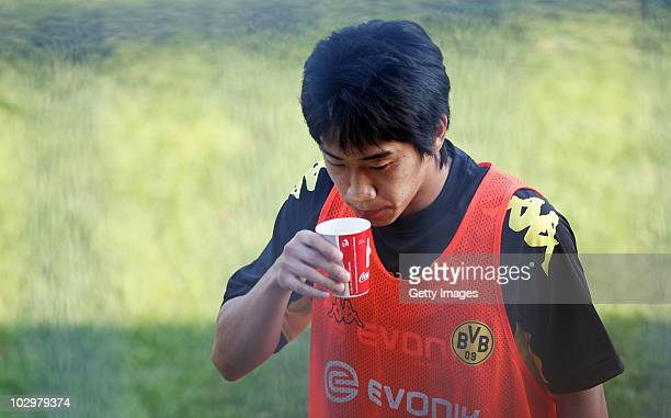 Shinji Kagawa drinks during the Borussia Dortmund Training Camp for the upcoming season 2010/2011 on July 19 2010 in Stegersbach Austria