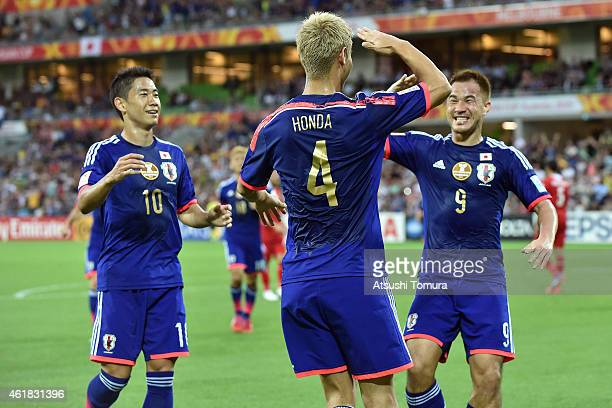 Shinji Kagawa Keisuke Honda and Shinji Okazaki of Japan celebrate a Keisuke Honda goal during the 2015 Asian Cup match between Japan and Jordan at...