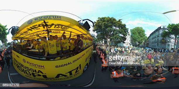 Shinji Kagawa leads the team celebrations during a parade near Borsigplatz for the celebrations of Borussia Dortmund's DFB Cup win on May 28 2017 in...