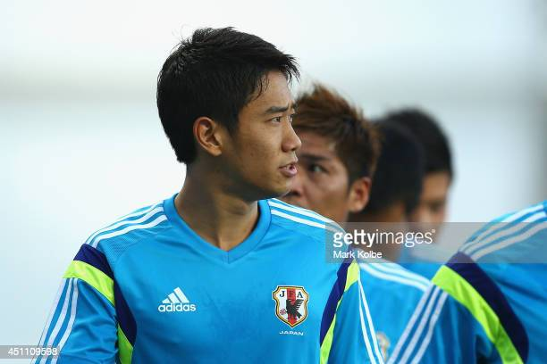 Shinji Kagawa looks on during a Japan training session at Arena Pantanal on June 23 2014 in Cuiaba Mato Grosso
