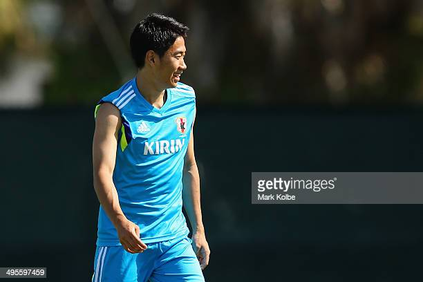 Shinji Kagawa looks on during a Japan training session at North Greenwood Recreation Aquatic Complex on June 4 2014 in Clearwater Florida