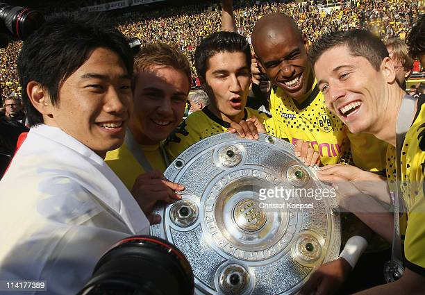 Shinji Kagawa Marfio Goetze Nuri Sahin Felipe Santana and Robert Lewandowski of Dortmund hold the German Champions trophy after the Bundesliga match...