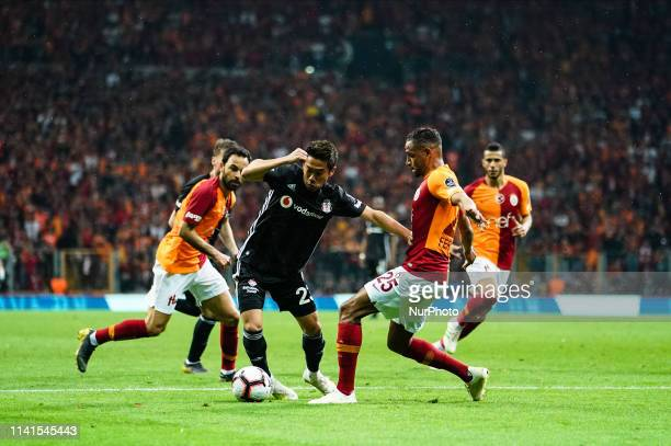 Shinji Kagawa of Besiktas dribbling past Fernando of Galatasaray during the Turkish Super Lig match between Galatasaray SK and Besiktas at the Türk...