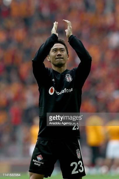 Shinji Kagawa of Besiktas greets fans before the Turkish Super Lig week 31 football match between Galatasaray and Besiktas at Turk Telekom Stadium in...