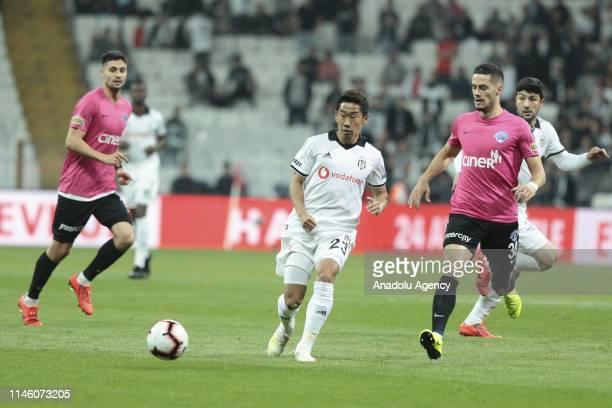 Shinji Kagawa of Besiktas in action against Haris Hajradinovic of Kasimpasa during Super Lig soccer match between Besiktas and Kasimpasa at Vodafone...