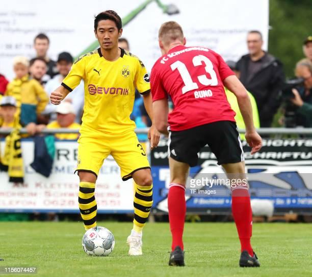 Shinji Kagawa of Borussia Dortmund and Marcel Bund of FC Schweinberg battle for the ball during the preseason friendly match between FC Schweinberg...