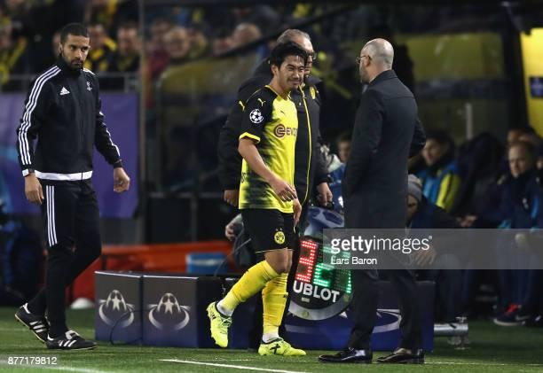 Shinji Kagawa of Borussia Dortmund and Peter Bosz head coach of Borussia Dortmund speak when Shinji Kagawa is substituted during the UEFA Champions...