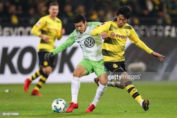 Shinji Kagawa of Borussia Dortmund and William of VfL Wolfsburg battle for the ball during the Bundesliga match between Borussia Dortmund and VfL...