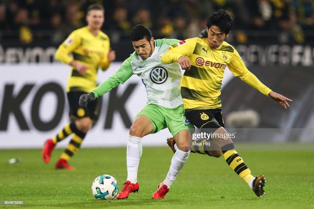 Shinji Kagawa #23 of Borussia Dortmund and Yunus Malli #10 of VfL Wolfsburg battle for the ball during the Bundesliga match between Borussia Dortmund and VfL Wolfsburg at Signal Iduna Park on January 14, 2018 in Dortmund, Germany.