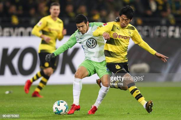 Shinji Kagawa of Borussia Dortmund and Yunus Malli of VfL Wolfsburg battle for the ball during the Bundesliga match between Borussia Dortmund and VfL...