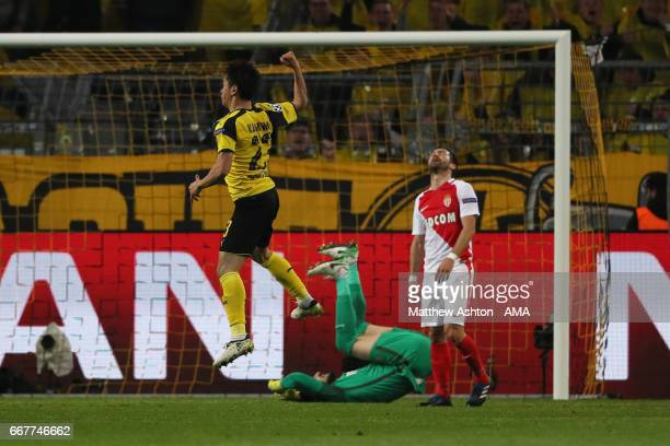 Shinji Kagawa of Borussia Dortmund celebrates after scoring a goal to make it 23 during the UEFA Champions League Quarter Final first leg match...