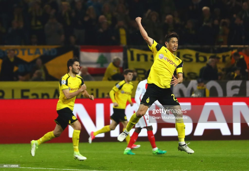 Shinji Kagawa of Borussia Dortmund celebrates after scoring his team's second goal of the game during the UEFA Champions League Quarter Final first leg match between Borussia Dortmund and AS Monaco at Signal Iduna Park on April 12, 2017 in Dortmund, Germany. The match was rescheduled after an alleged terrorist attack on the Borussia Dortmund team coach as it made it's way to the stadium.