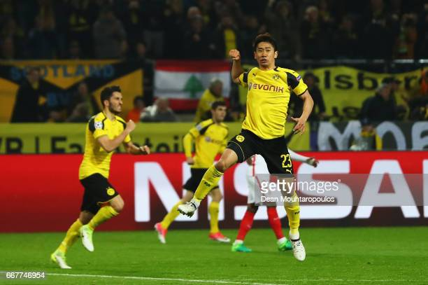 Shinji Kagawa of Borussia Dortmund celebrates after scoring his team's second goal of the game during the UEFA Champions League Quarter Final first...