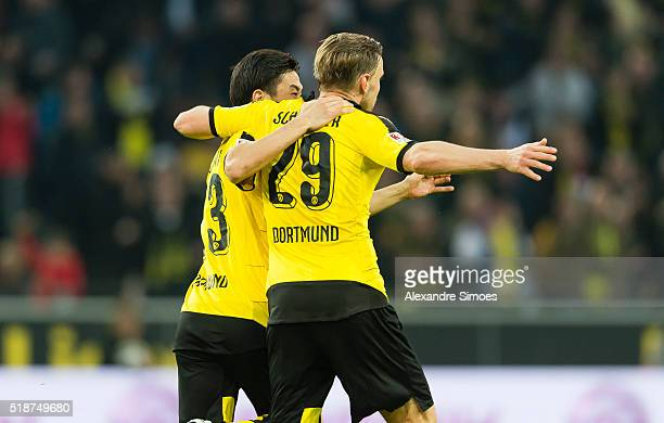Shinji Kagawa of Borussia Dortmund celebrates after scoring the goal to the 22 together with his team mates during the Bundesliga match between...