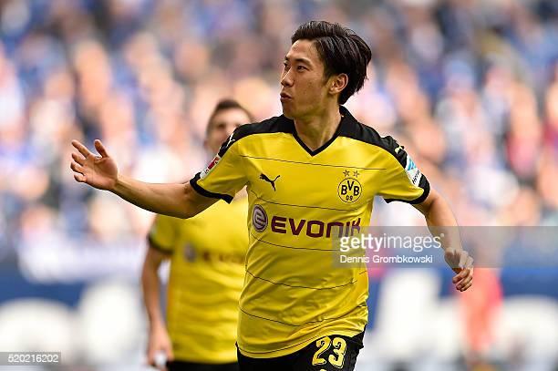 Shinji Kagawa of Borussia Dortmund celebrates after scoring the opening goal during the Bundesliga match between FC Schalke 04 and Borussia Dortmund...