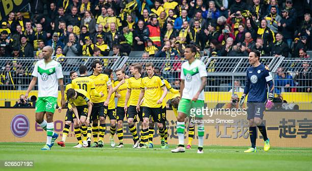 Shinji Kagawa of Borussia Dortmund celebrates after scoring the opening goal together with his team mates during the Bundesliga match between...