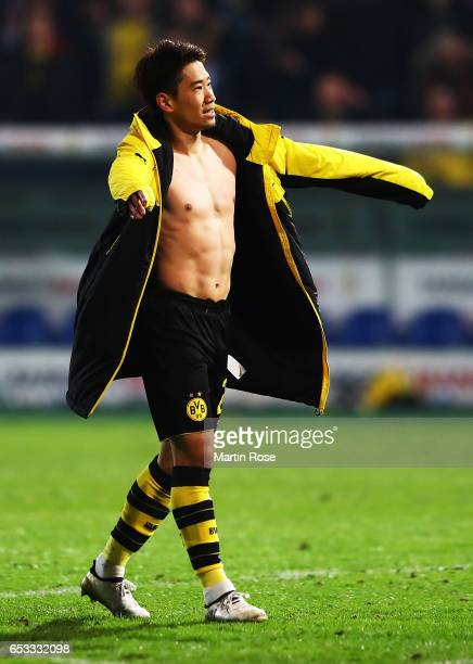 Shinji Kagawa of Borussia Dortmund celebrates after victory in the DFB Cup quarter final between Sportfreunde Lotte and Borussia Dortmund at...